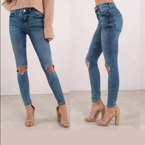 Free People medium wash knee out jeans